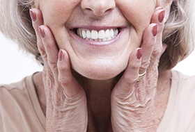 Closeup of beautiful, healthy older smile with dental implants in Corbin