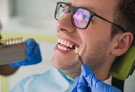 Smiling young man getting dental implants in Corbin