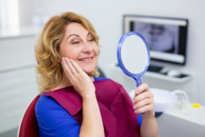 Woman admiring her new dental implants